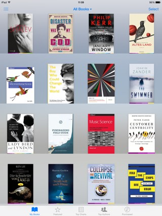 Screenshot of iBooks showing covers with a multi-coloured strip at the bottom of book covers
